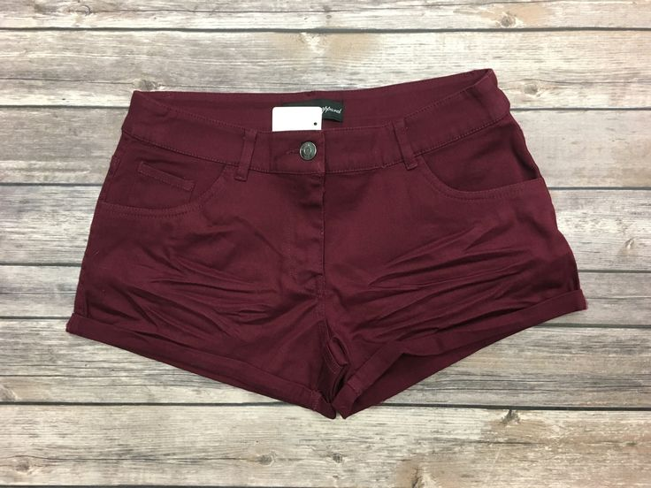 The Simply Perfect Shorts: Burgundy are exactly as their name states...simply perfect! A great burgundy hue, rolled hemline, single button, and pockets! Pair these shorts with all of your favorite tee