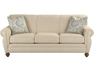 Beautifully shaped Bombay arms are the focus of this classic traditional sleeper sofa.  It features an easy-to-maintain tight back, 3 seat cushions, and elegant turned legs.