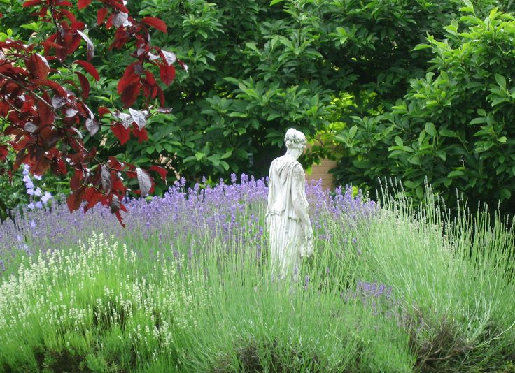 Great English Fantasy Garden Design. The Statue Appears To Be Looking For  Something, But