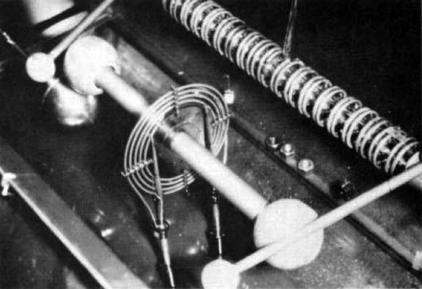 A 5 million volt Tesla coil developed for nuclear physics research in 1929 by G. Breit, M. A. Tuve, and O. Dahl. The multi-sectioned vacuum tube at the upper right was used to accelerate atomic particles. (Photo courtesy of T. Brown, Dept. of Terrestrial Magnetism, Carnegie Institution of Washington)