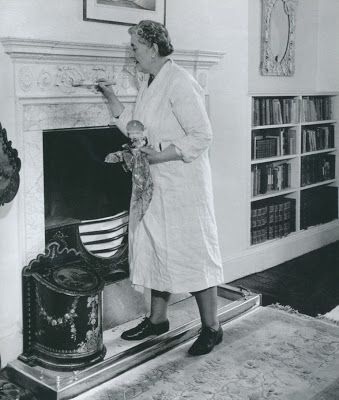 Agatha Christie painting her bedroom fireplace at Greenway