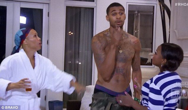 Out of control: Tammy tried to stop her nephew Glen Rice Jr on Sunday's episode of The Real Housewives Of Atlanta