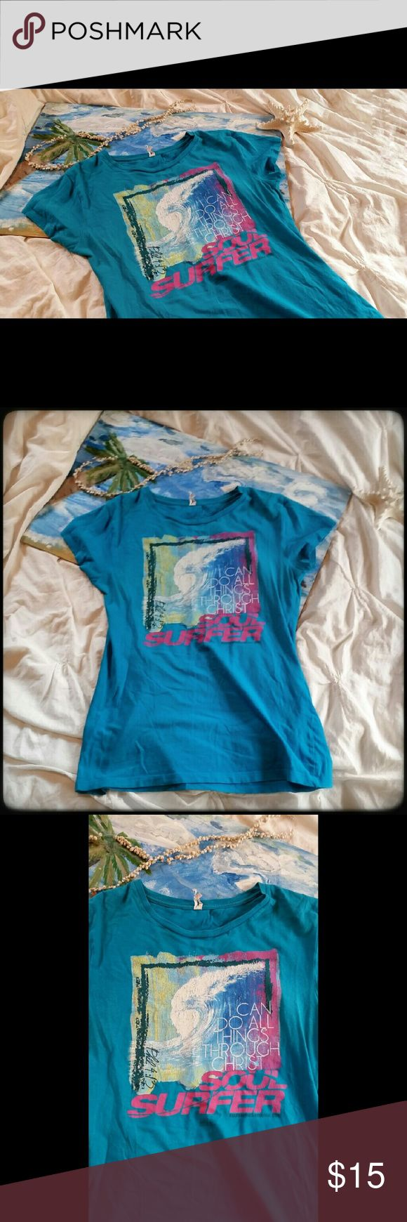 "Soul Surfer T-Shirt Pre-loved dark aqua colored Christian tee shirt with a watercolor style wave and promoting the movie Soul Surfer, inspired by Bethany Hamilton's story. Has Philippians 4:13 """"I can do all things through Christ"""" on it. Minor cracking on iron on design and damaged label tag--otherwise excellent condition.   Additional keywords: ocean beach sea surfing pro surfer biography biographical inspirational inspiring motivational motivating Bible verse scripture quote graphic tee…"