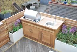 We love the idea of having an outdoor-kitchen on our roof terrace! Here you have everything you need for a relaxed BBQ. The lovely wooden kitchen could also fit in any British home.     That modern roof terrace is designed by Aralia.