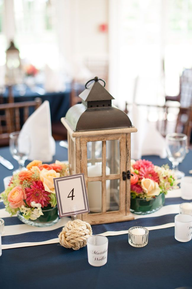 Wood lantern centerpieces | Coral & Navy Vintage Inspired Nautical Wedding At The Ribault Club Jacksonville Florida | Photograph by Britney Kay Photography   http://storyboardwedding.com/vintage-nautical-wedding-ribault-club-jacksonville-florida