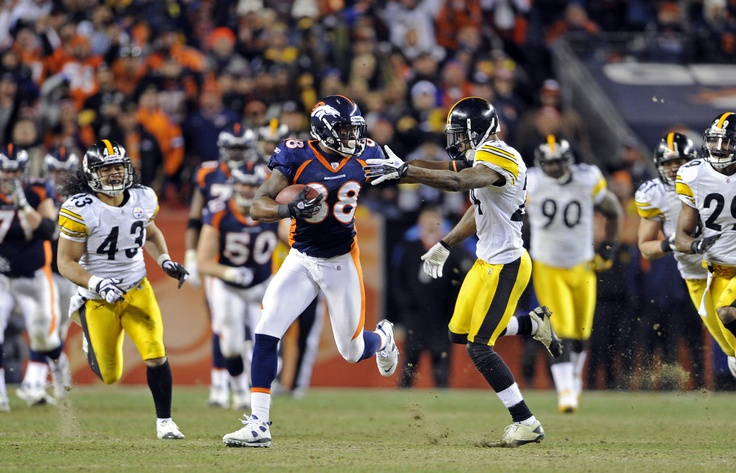 Wide receiver Demaryius Thomas (88) scores on a game-winning 80-yard touchdown catch in overtime during an NFL Wildcard Playoff football game. (AP Photo/Greg Trott)