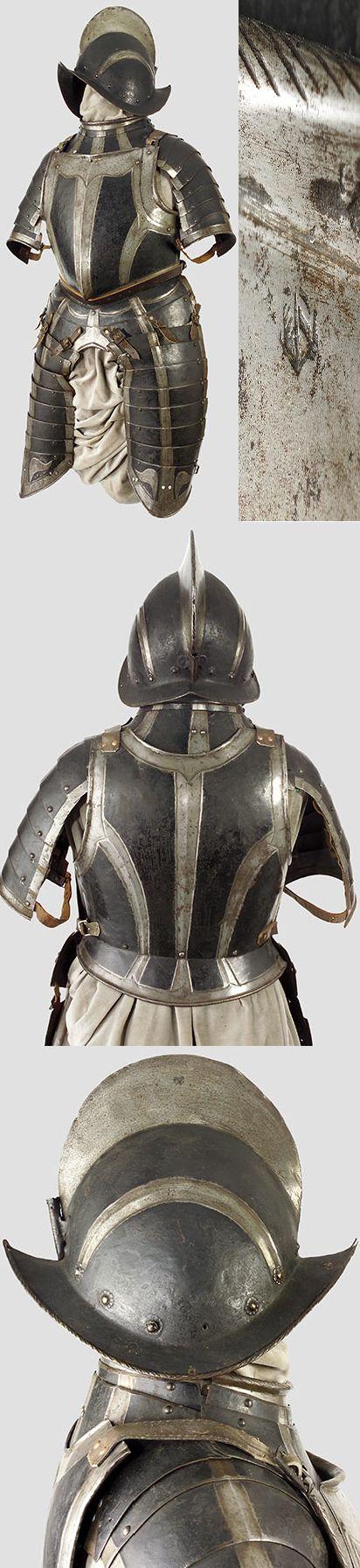 A black and white half-armour  Nuremberg, circa 1580/90 .