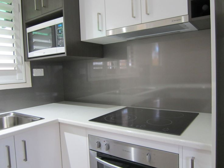 """For a dramatic effect this Laminex Metaline kitchen splashback in """"NIMBUS METALLIC"""" would have to rate among the best. It's one of those colours that fit most kitchen designs as you can dress it up by surrounding it with a large range of coloured ornaments or leave it neutral to enhance the clean lines that are brought out so well by the high gloss of the material."""