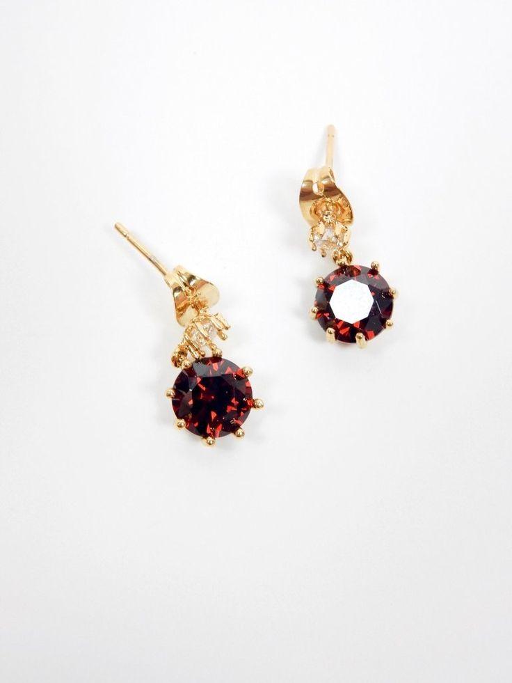 The Ruby Rhinestone Mini Drop Earrings feature diamanté studs, mini drop design with rhinestone embellishment, and stud back closures.