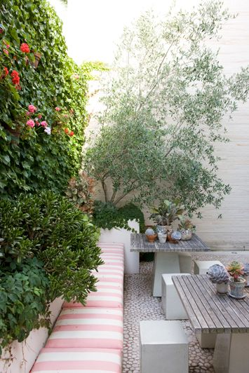 bench seat along living wall -  but use small round tables instead of rectangle maybe?