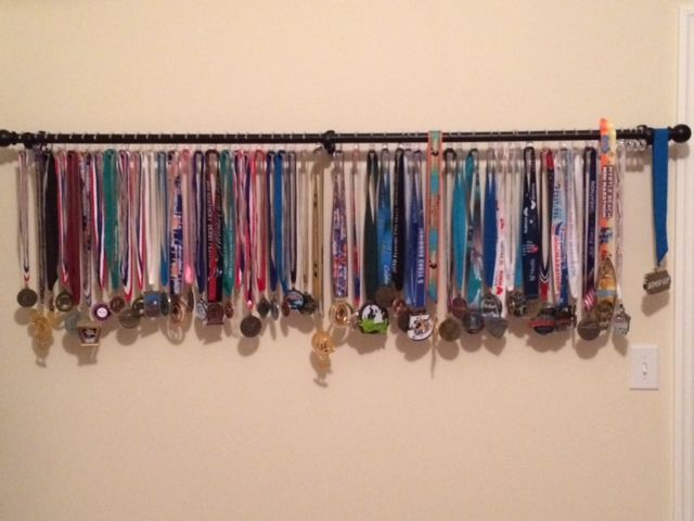 a curtain rod on the wall with shower curtain hooks to easily hang medals from 45 half. Black Bedroom Furniture Sets. Home Design Ideas