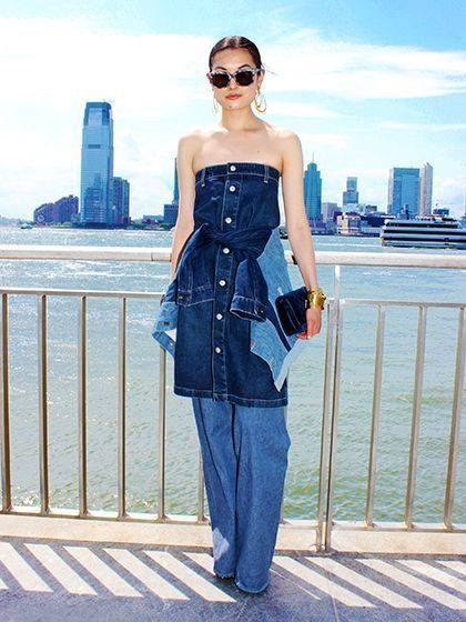 Alexa Chung AG Jeans A-line skirt belted with a Proenza Schouler jacket and layered over wide-leg denim   allure.com