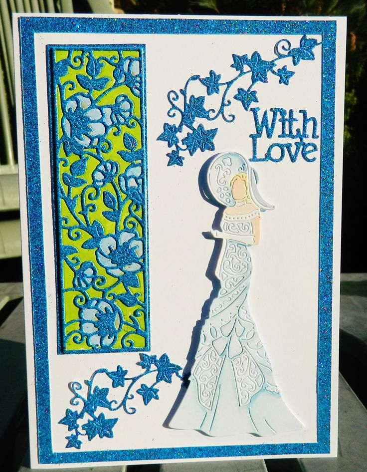My hubby got me the Tattered Lace magazine subscription (yes I did ask for it ,he's not that good! ), with it comes lots of gorgeous free dies and I have used them to make this card . The lovely lady is called Dolly and I've coloured her with pro markers . To the panel die I've coloured the flowers with promakers then over layered in blue glitter card and used the glitter card for the frame, sentiment and ivy die cuts ...well it is still Christmas and we all love a bit of sparkle. I've manag