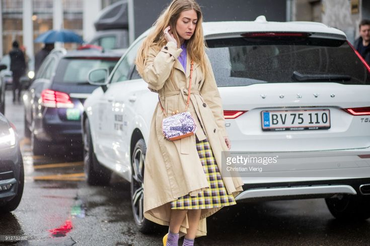 Emili Sindlev wearing trench coat, Burberry bag, graphic print skirt outside J. Lindeberg during the Copenhagen Fashion Week Autumn/Winter 18 on January 31, 2018 in Copenhagen, Denmark.
