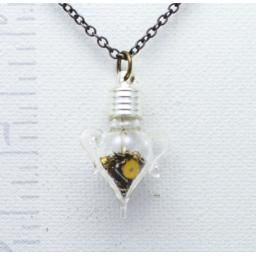 Amphora Necklace : Handmade in Canada, this sweet pendant is filled with vintage watch parts that move freely in the their glass amphora container.