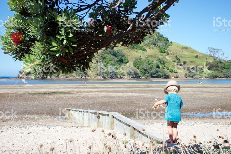 Child in Straw Sun Hat with Dinosaur at Beach royalty-free stock photo