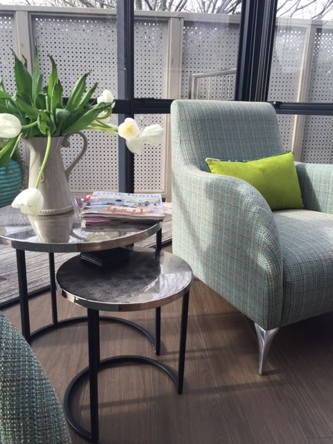 Outdoor Unique fabric to with stand the direct sun from an overhead glass roof. Metal side tables