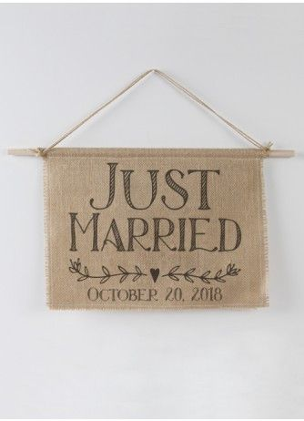 Announce your status with this rustic burlap sign. Just Married is printed in black ink on burlap fabric backed with natural colored canvas. The burlap and canvas are sewn together for stability altho