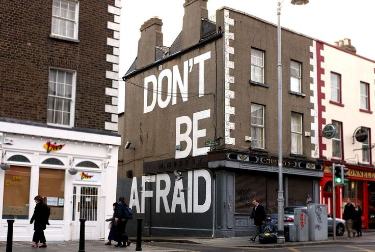 "Dublin artist Maser has painted poet Seamus Heaney's last words ''Don't be afraid"" on a gable wall in the city"