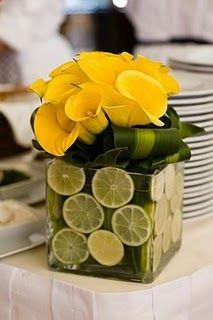 Yellow calla lilies combined with sliced limes is a fresh new take on a summer centerpiece!