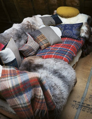 sofa covered in plaid