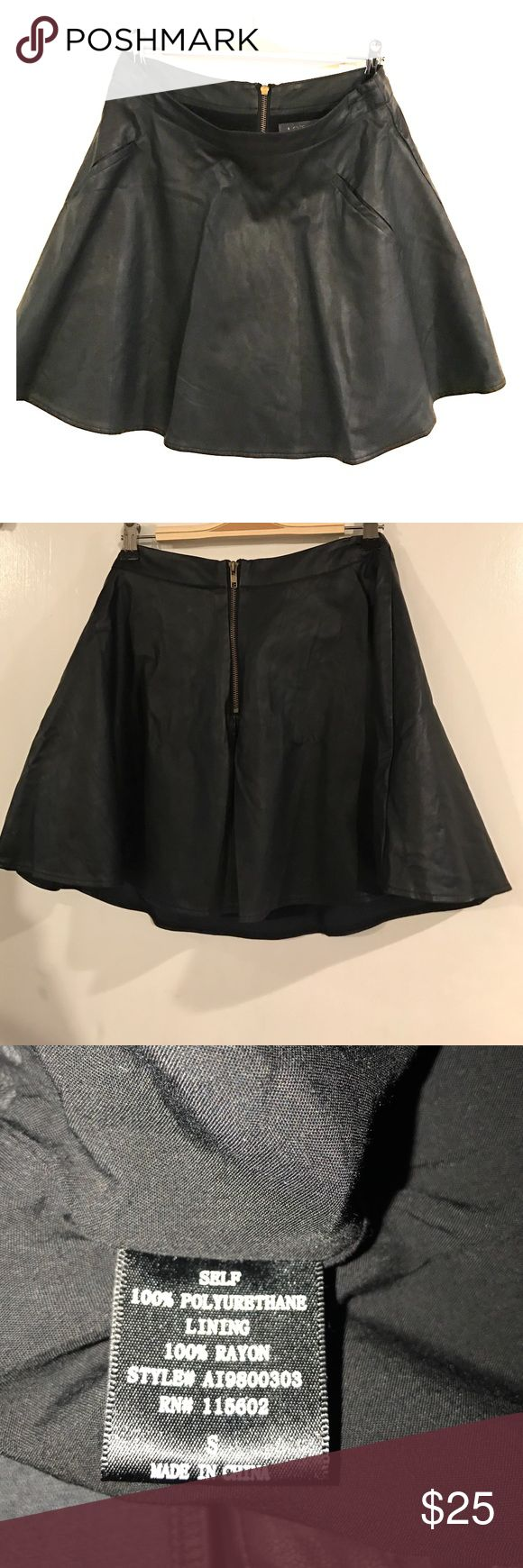 Faux leather mini skater skirt Black faux leather mini skater skirt with back zipper. Worn once. Lined ASTR Skirts Circle & Skater
