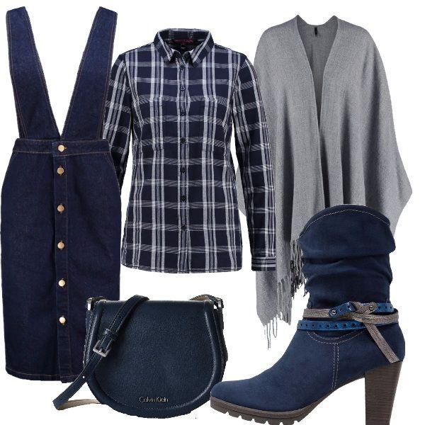 La gonna di jeans con i bottoni è stato un must dell'estate ma sarà anche di gran moda questo inverno. Quì ve la propongo in versione salopette, abbinata ad una camicia a quadri, ad uno stivaletto texano e ad una mantella grigia. Come borsa, invece, vi consiglio questa tracollina blu comoda.