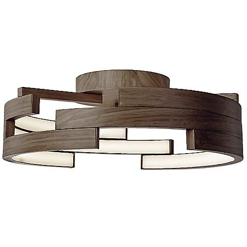 Dynamic and architectural, the Kuzco Lighting Anello LED Semi-Flushmount provides a different look from each angle it is viewed at. Three layers of arched metal bands form a ring with cut outs throughout that keep the piece interesting and energetic. Powered by sophisticated LEDs, the illumination is diffused through the inner acrylic shade, lighting the space with a contemporary air.