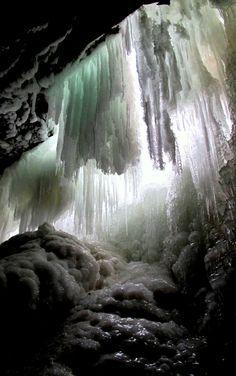 Hiking behind Frozen Waterfall. Upper Decew Falls, St. Catharines, Ontario, Canada.
