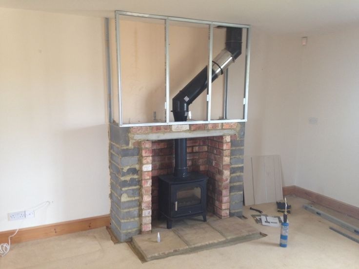 Tiled fireplace wall and Gas heater for home