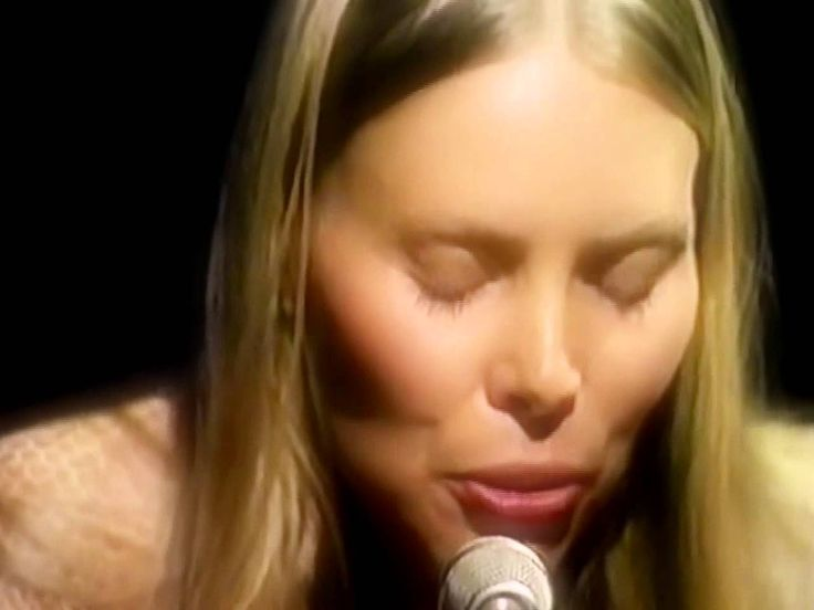 "Joni Mitchell - Woodstock (Live In-Studio 1970)  ""this is the most beautiful thing i've heard...shes a five year old girl, a 17 year old, a 40 yr old, and an 80 old pilgrim woman in one song and being...shes america...the absolutely stunning and frustrating america"""