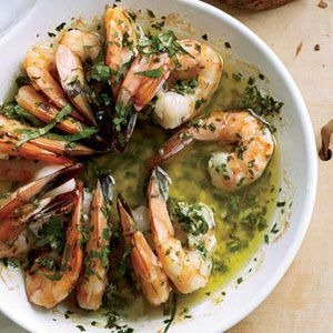 Scampi refers to shrimp that are split, brushed with garlicky butter and broiled. The recipe here calls for flavoring butter with lemon, garlic, parsley and thyme, then dotting it liberally on shrimp and roasting the shellfish until it sizzles.