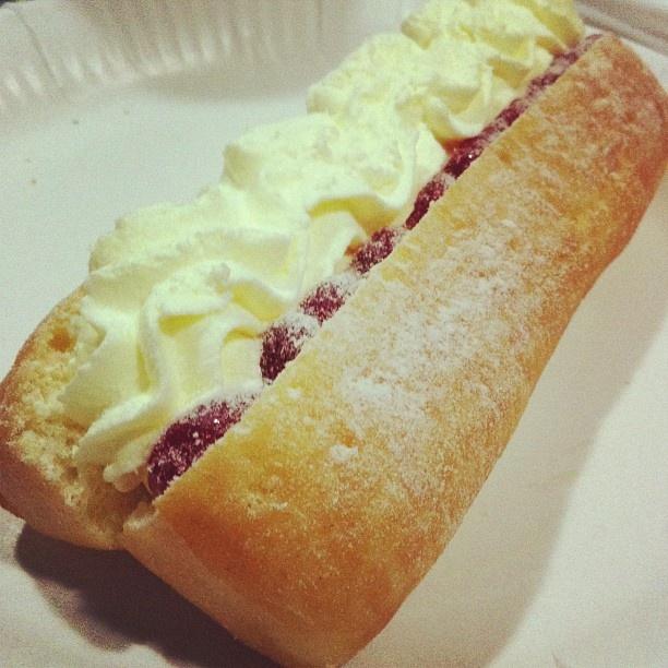 Cream and jam long John donut