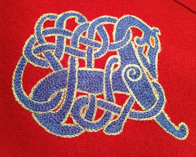 Embroidery on viking hood: the pattern must be out there somewhere. I've seen this in so many different colors.