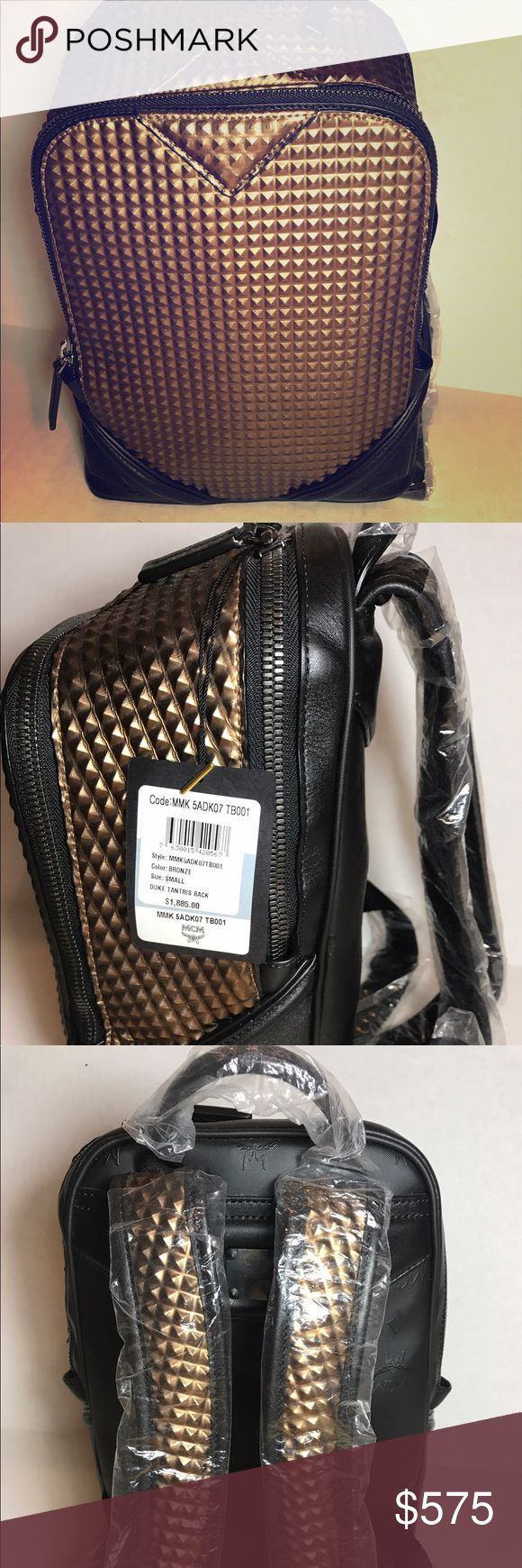 NEW MCM Bronze Duke Tantris Backpack Size Small New with tags and dust bag. Black with bronze/copper geometric cube embellishment. MCM Bags Backpacks