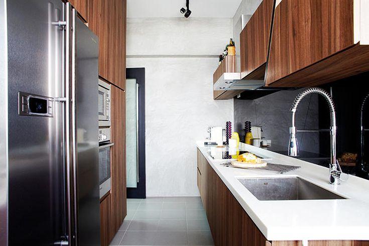 black tempered glass backsplash with unusual overhead kitchen cabinet