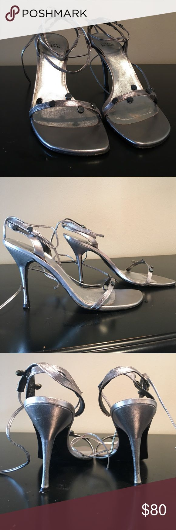 """Stuart Weitzman silver strappy sandals Stuart Weitzman sexy silver strappy sandals. Leather wrap ties at ankles. 4"""" heel. Normal wear on bottom. Upper in mint condition. Size 10 1/2. Stuart Weitzman Shoes"""