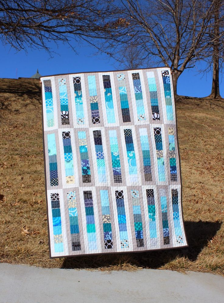 """Made with 2 1/2"""" squares, scraps or from a jelly roll and sashed in two colors to create a really striking, intricate look. From Teaginny Designs: Chance of Showers"""