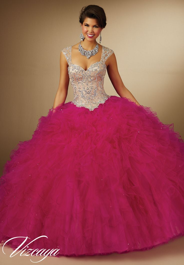 Quinceanera dresses by Vizcaya Two-Tone Ruffled Tulle with Beading Removable Beaded Shoulder Coverlet. Available in Fuchsia/Nude, Capri/Nude, White/Nude