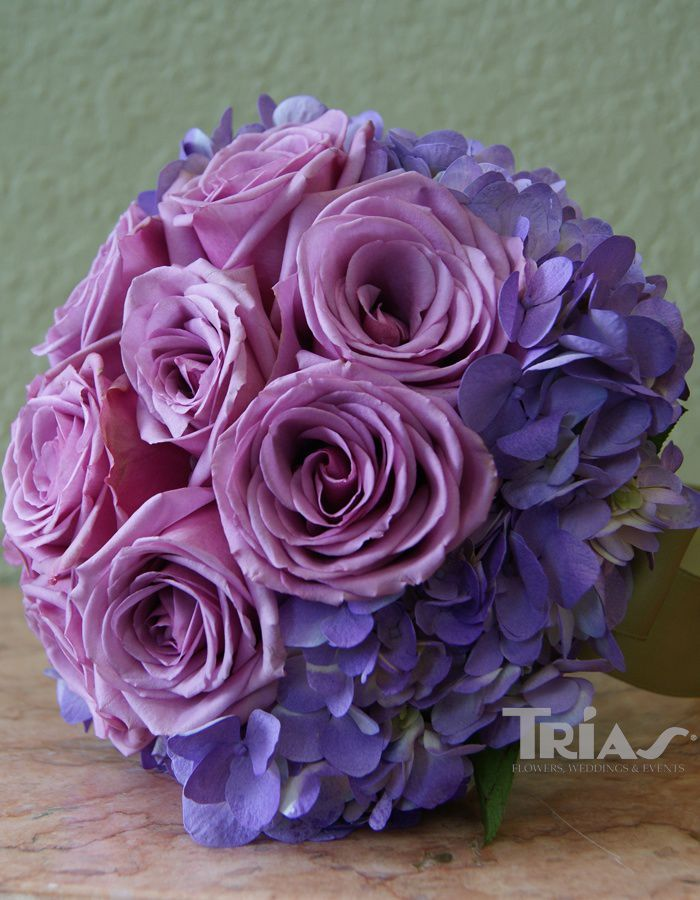 Gorgeous bouquet with purple roses and purple hydrangea.