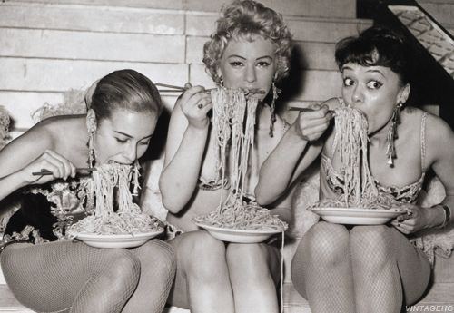Showgirls at the Soho Fair spaghetti eating contest, 10th July, 1958