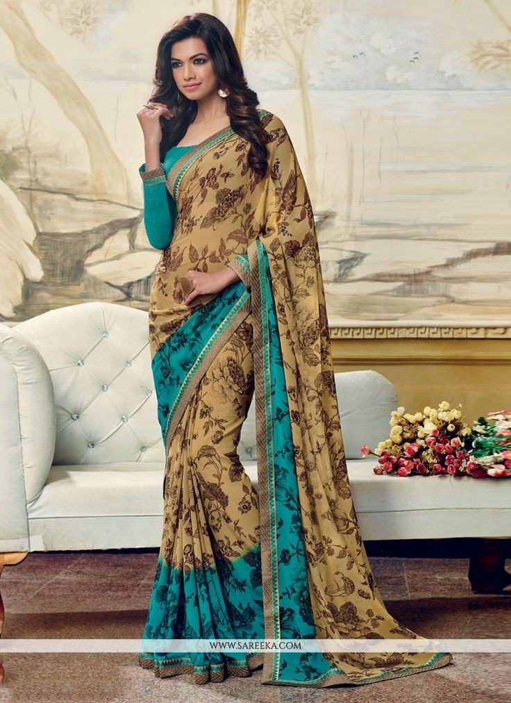Women splendor is magnified tenfold in this alluring multi colour georgette casual saree. This engaging dress is displaying some brilliant embroidery done with print work. Comes with matching blouse. ...