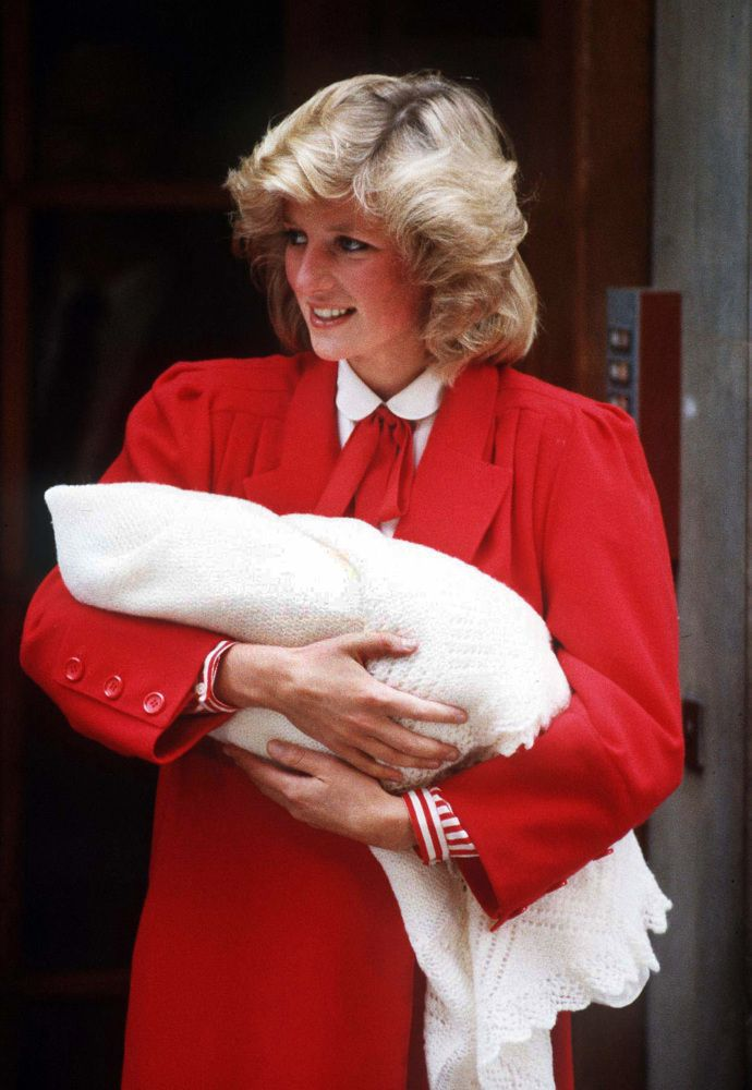 Diana, the Princess of Wales, with newborn Prince Harry, 1984.