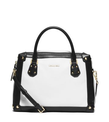 Bold contrasting trim lends graphic appeal to our Taryn satchel. A top-zip closure securely stows the essentials, while a sleek zip pocket at the back is ideal for stashing small items like keys and cards. Slip your arm through the tailored top handles or attach the crossbody strap for on-the-go style.