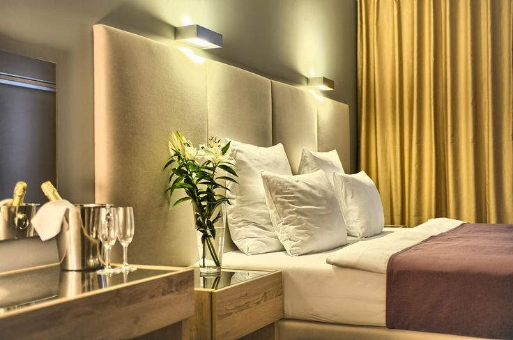 Cozy bedroom of the exclusive two bedroom apartment No. 52 in the Art Residence Krocinova, Prague.