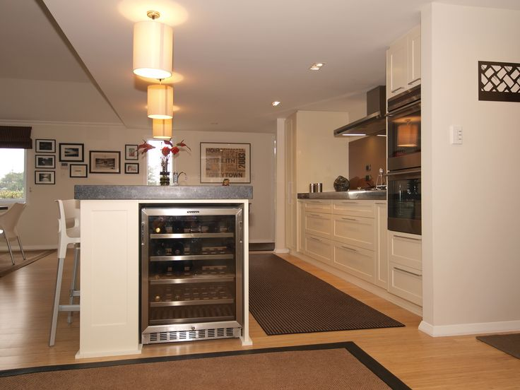 Crosses Line Kitchen Design by Prestige Joinery. #kitchen #interiordesign #kitchendesign #acrygloss #stone #stainlesssteel #prestigejoinery #prestigekitchenswairarapa