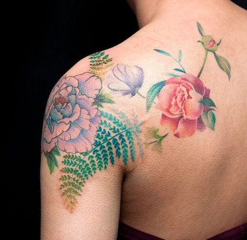 Flowers tattoo by Cheo Park at East Side Ink in NYC