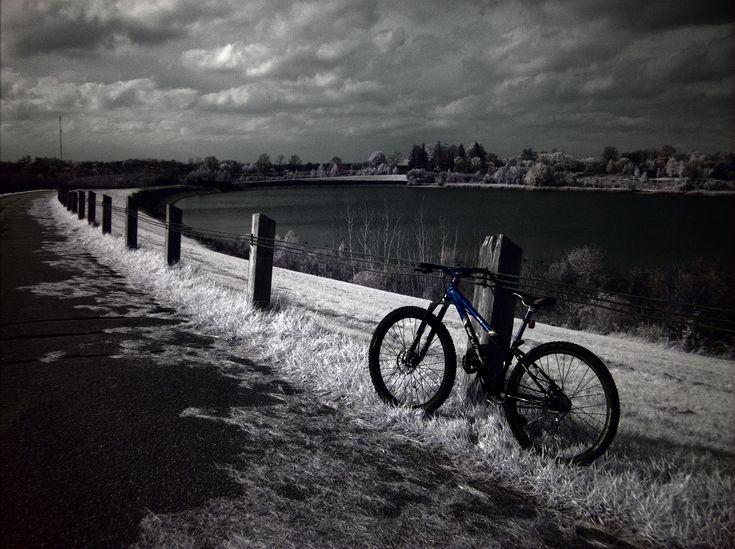 Biking on the top of Guelph Lake's dam.