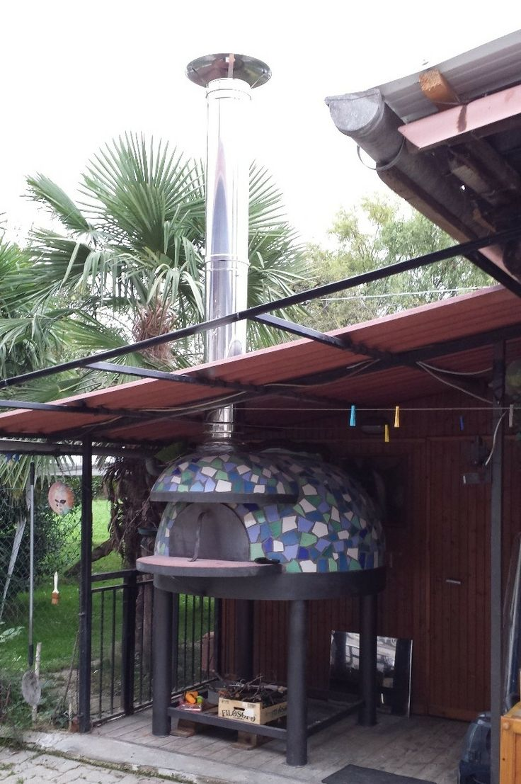 garden pizza oven with beautiful tile mosaic