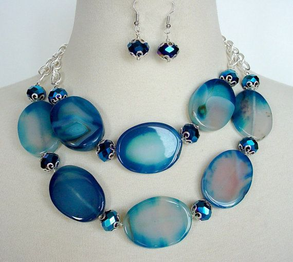Blue Statement Necklace, Big Bold Chunky Necklace, Large Bead Necklace, Royal Blue Agate Necklace    Paloma is a striking royal blue and white agate Agate necklace that is sure to bring plenty of attention to your outfit! Large oval Agate stones are accented with vivid faceted blue crystal and silver beadcaps and chain. The combination is perfect - elegant and simple and yet it makes a huge statement. Matching earrings are included. The inner strand of the necklace is 18 long and the…